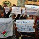 15 Photos où les Libyens demandent pardon au peuple Américain