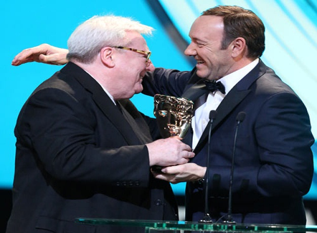 Alan Parker receives his Bafta lifetime achievement award from Kevin Spacey