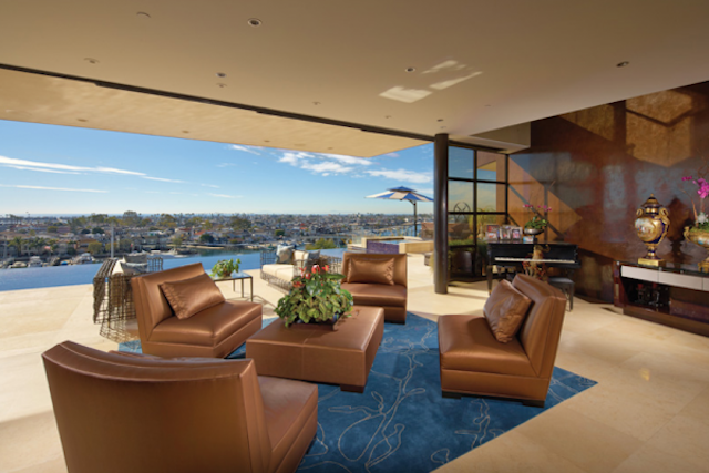 the-glass-walls-in-this-living-room-are-motorized-so-that-they-open-when-you-want-some-fresh-air-600x400