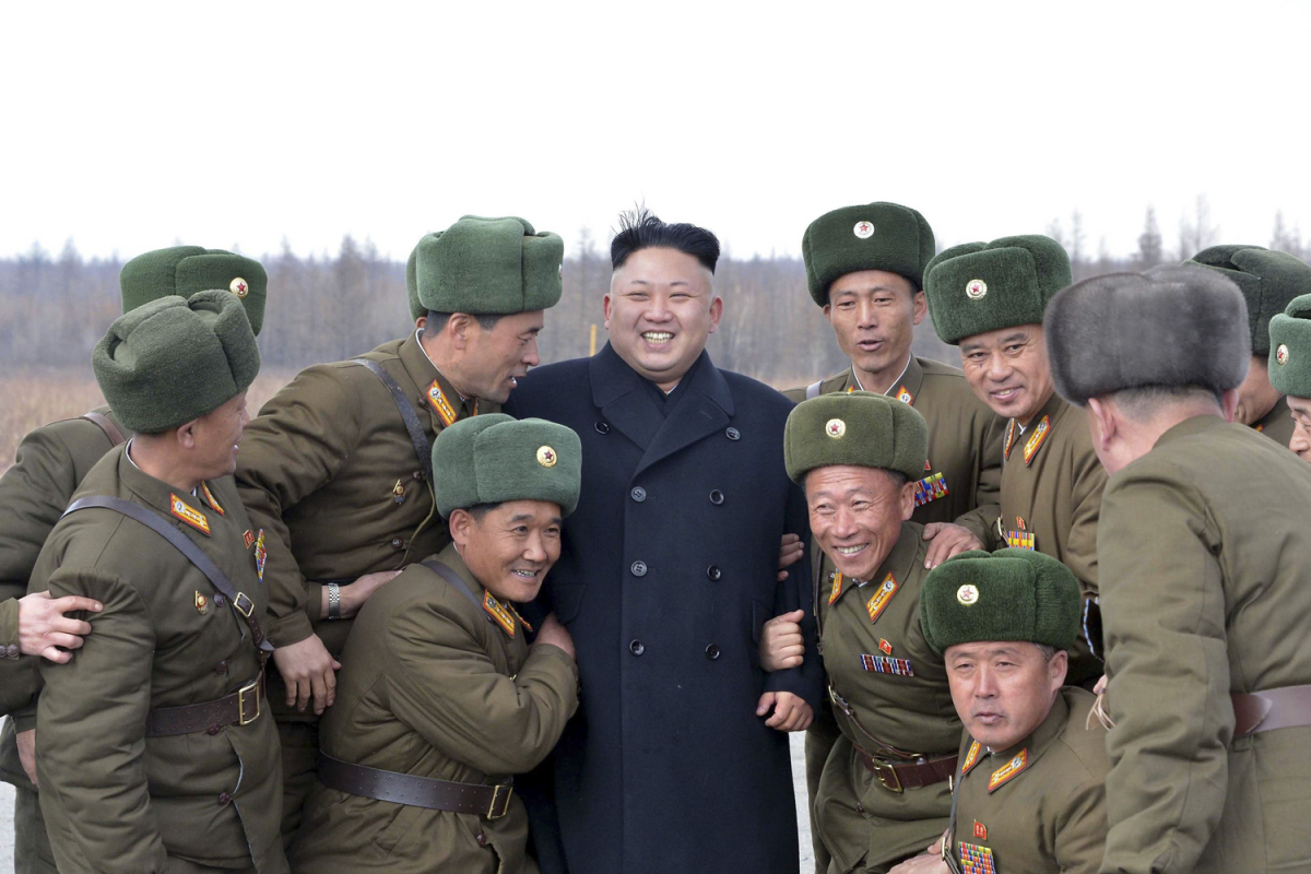 North Korean leader Kim Jong Un smiles as he stands with commanding officers of the combined units of the Korean People's Army (KPA)