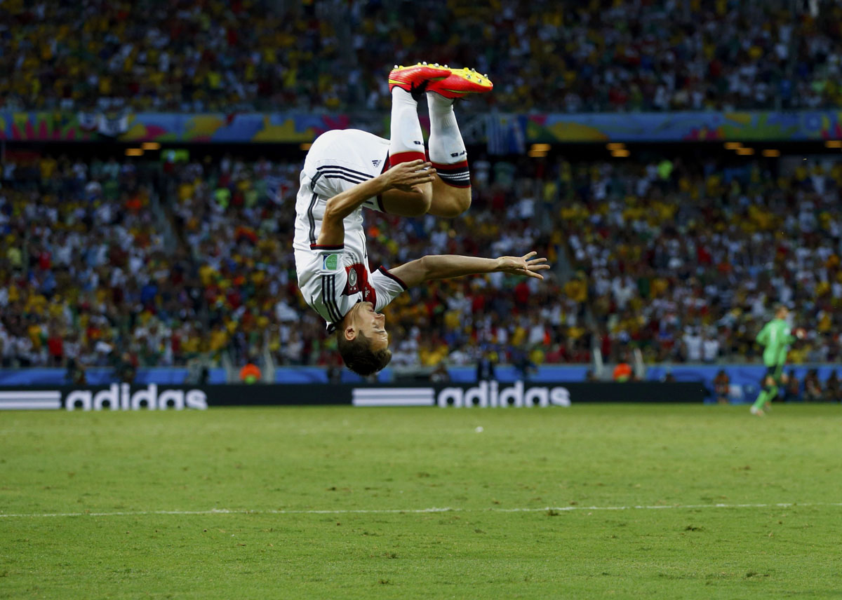 Germany's Miroslav Klose celebrates after scoring against Ghana during their 2014 World Cup Group G soccer match at the Castelao arena in Fortaleza