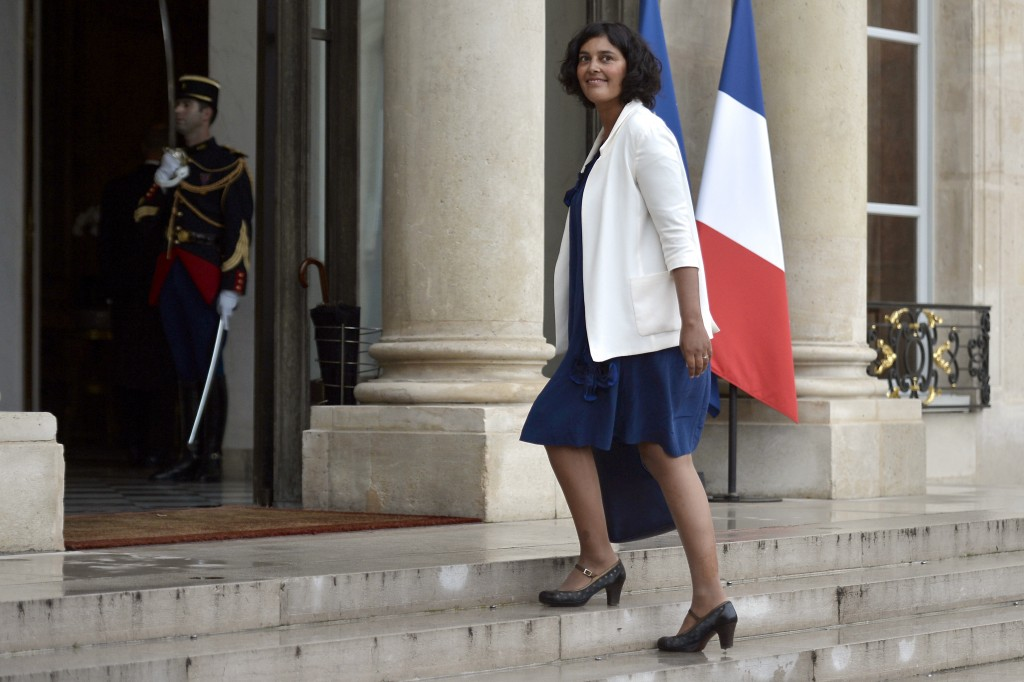 "Junior minister for Urban Affairs Myriam El Khomri arrives on August 27, 2014 at the Elysee presidential palace in Paris for a weekly cabinet meeting. French President Francois Hollande on August 27 installed a former banker and ally as economy minister in an emergency reshuffle seen as the ""last chance"" to haul France out of the biggest crisis of his presidency. Hollande caught everyone off guard with the appointment of Emmanuel Macron, a 36-year-old ex-Rothschild banker and architect of the president's economic policy. AFP PHOTO / FRED DUFOUR"