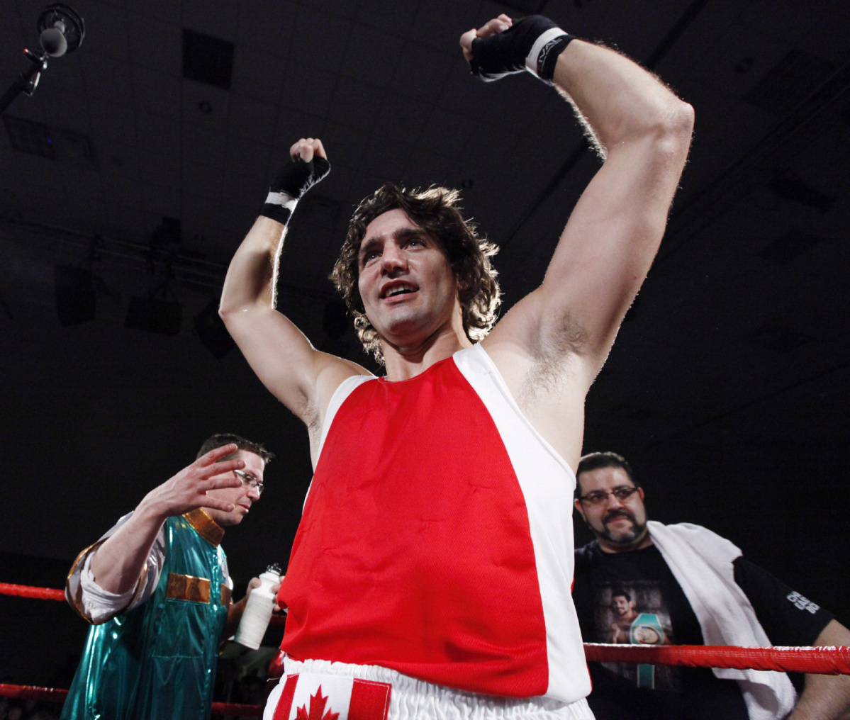 Liberal MP Justin Trudeau raise his arms after he defeated Conservative Senator Patrick Brazeau during charity boxing match for cancer research Saturday, March 31, 2012 in Ottawa . THE CANADIAN PRESS/Fred Chartrand