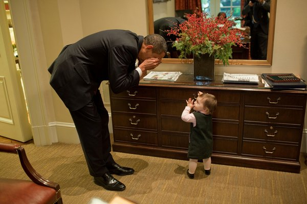 President Barack Obama plays with the daughter of Emmett Beliveau, the director of advance, in the Outer Oval Office, Oct. 30, 2009. (Official White House Photo by Pete Souza) This official White House photograph is being made available only for publication by news organizations and/or for personal use printing by the subject(s) of the photograph. The photograph may not be manipulated in any way and may not be used in commercial or political materials, advertisements, emails, products, promotions that in any way suggests approval or endorsement of the President, the First Family, or the White House.