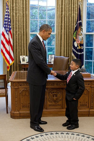 President Barack Obama fist-bumps Make-a-Wish child Juan Blanco in the Oval Office, Oct. 6, 2010. (Official White House Photo by Pete Souza) This official White House photograph is being made available only for publication by news organizations and/or for personal use printing by the subject(s) of the photograph. The photograph may not be manipulated in any way and may not be used in commercial or political materials, advertisements, emails, products, promotions that in any way suggests approval or endorsement of the President, the First Family, or the White House.