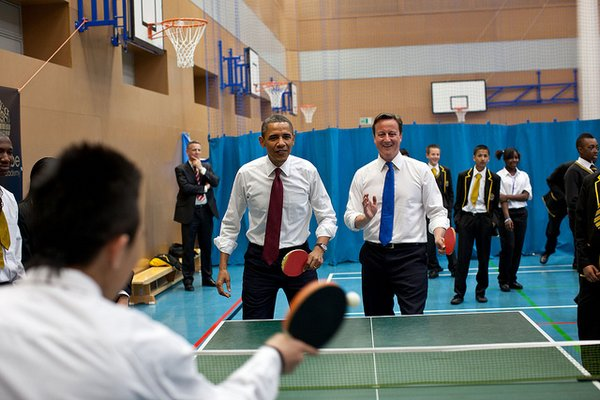 President Barack Obama and British Prime Minister David Cameron play table tennis with students at Globe Academy in London, England, May 24, 2011. (Official White House Photo by Pete Souza) This official White House photograph is being made available only for publication by news organizations and/or for personal use printing by the subject(s) of the photograph. The photograph may not be manipulated in any way and may not be used in commercial or political materials, advertisements, emails, products, promotions that in any way suggests approval or endorsement of the President, the First Family, or the White House.