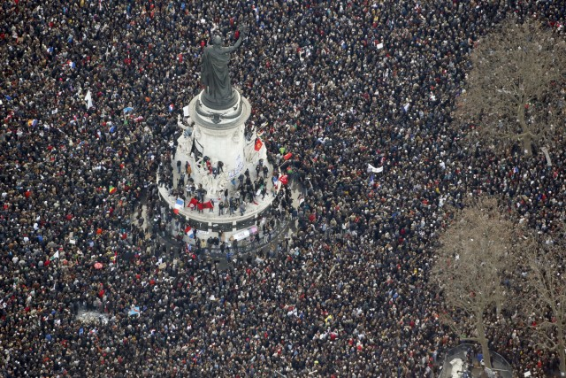"""– AFP PICTURES OF THE YEAR 2015 – Aerial view taken on January 11, 2015 shows people attending the Unity rally """"Marche Republicaine"""" at the Place de la Republique (Republique's square) in Paris in tribute to the 17 victims of a three-day killing spree by homegrown Islamists. The killings began on January 7 with an assault on the Charlie Hebdo satirical magazine in Paris that saw two brothers massacre 12 people including some of the country's best-known cartoonists, the killing of a policewoman and the storming of a Jewish supermarket on the eastern fringes of the capital which killed 4 local residents. AFP PHOTO / KENZO TRIBOUILLARD / AFP / KENZO TRIBOUILLARD"""