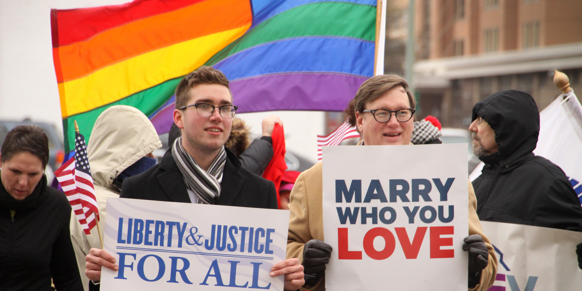 NORFOLK, VA - FEBRUARY 4: Spencer Geiger (left) and Carl Johansen protest for equal marriage outside the Walter E. Hoffman U.S. Courthouse as oral arguments in the case of Bostic v Rainey proceed on February 4, 2014 in Norfolk, Virginia, Virginia Attorney General Mark Herring has concluded that Virginia's ban on gay marriage is unconstitutional and he will no longer defend it in federal lawsuits. Jay Paul/Getty Images/AFP