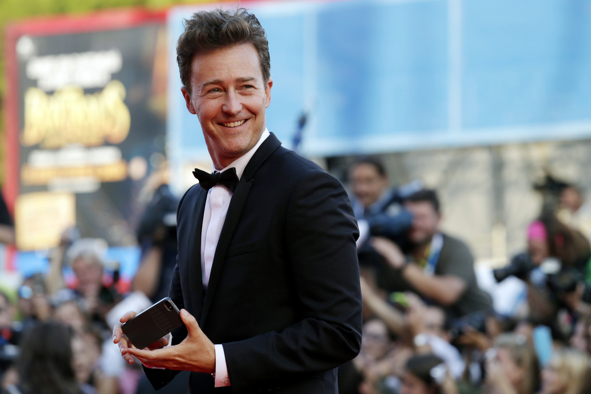 Actor Edward Norton smiles after taking a photograph of director Alejandro Gonzalez Inarritu as they arrive for the screening of Birdman during the opening ceremony for the 71st edition of the Venice Film Festival in Venice, Italy, Wednesday, Aug. 27, 2014. The 71st edition of the festival opens on Wednesday, Aug. 27th and runs until Sept. 6. (AP Photo/David Azia)