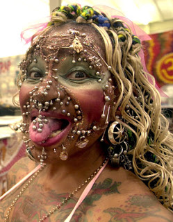 The world's most pierced woman, Elaine Davidson from Brazil, a resident in the Scottish city of Edinburgh, poses for a photographer during the 6th Ti-Tattoo Convention in Lugano, Switzerland, late Friday, Aug. 27, 2004. Davidson claims to have upwards of 1,900 piercings, and has an entry in the Guinness Book of World Records.