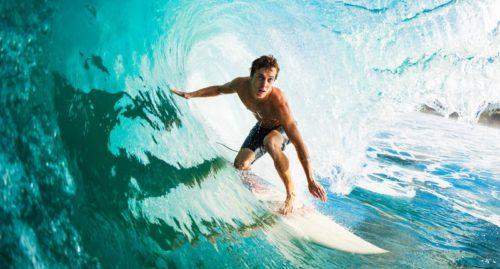 a-man-surfing-shutterstock-800x430