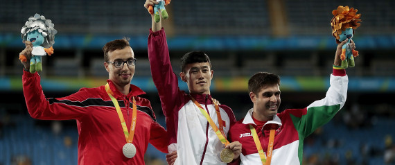 RIO DE JANEIRO, BRAZIL - SEPTEMBER 09: (L-R) Silver medalist Mahdi Afri of Morocco, gold medalist Qichao Sun of China and bronze medalist Luis Goncalves of Portugal celebrate on the podium at the medal ceremony for the Men's 400m T12 Final during day 2 of the Rio 2016 Paralympic Games at the Olympic Stadium on September 9, 2016 in Rio de Janeiro, Brazil. (Photo by Alexandre Loureiro/Getty Images)