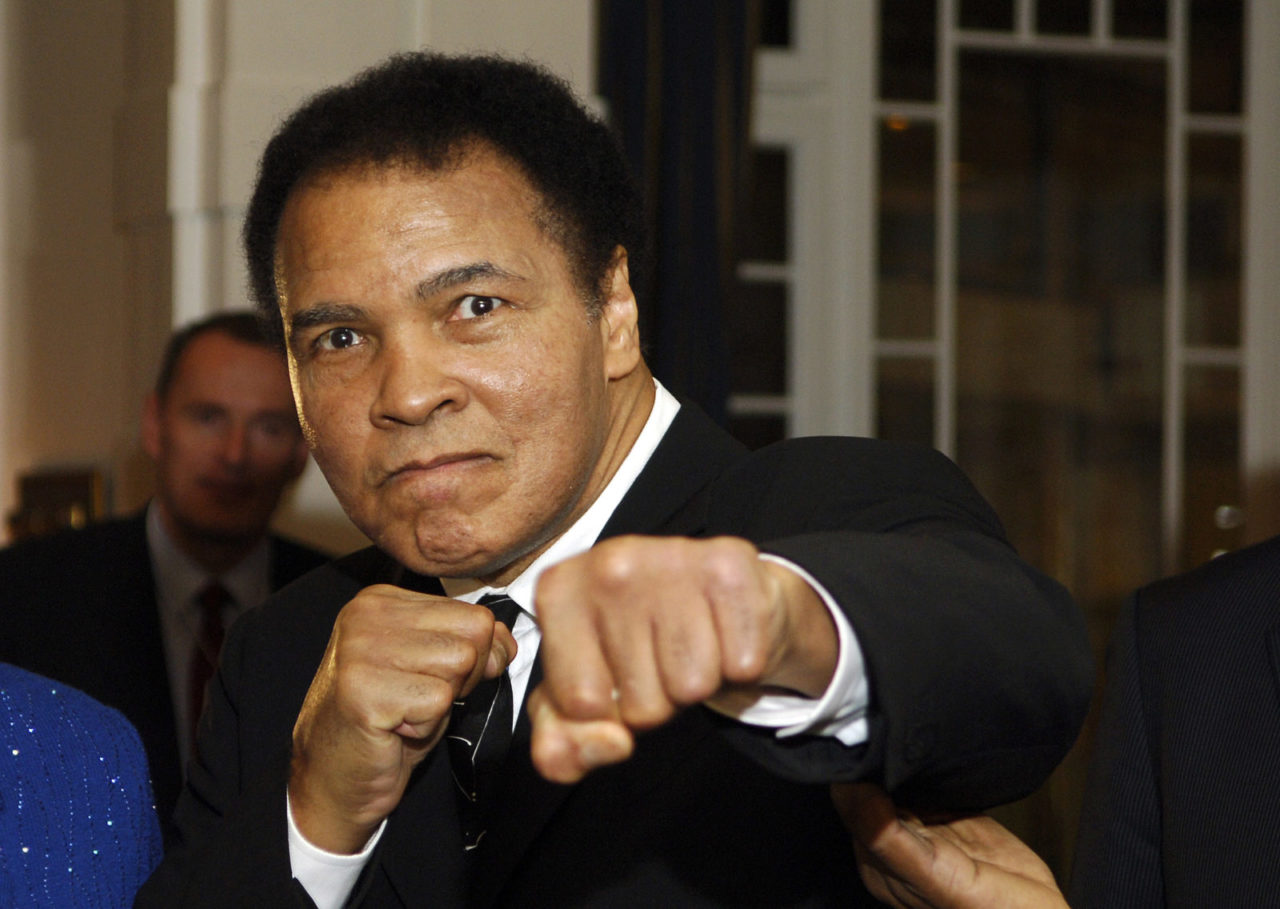US former heavyweight boxing champion Muhammad Ali gives a punch in front of photographers at hotel Belvedere in Davos 28 January 2006. AFP PHOTO ERIC FEFERBERG
